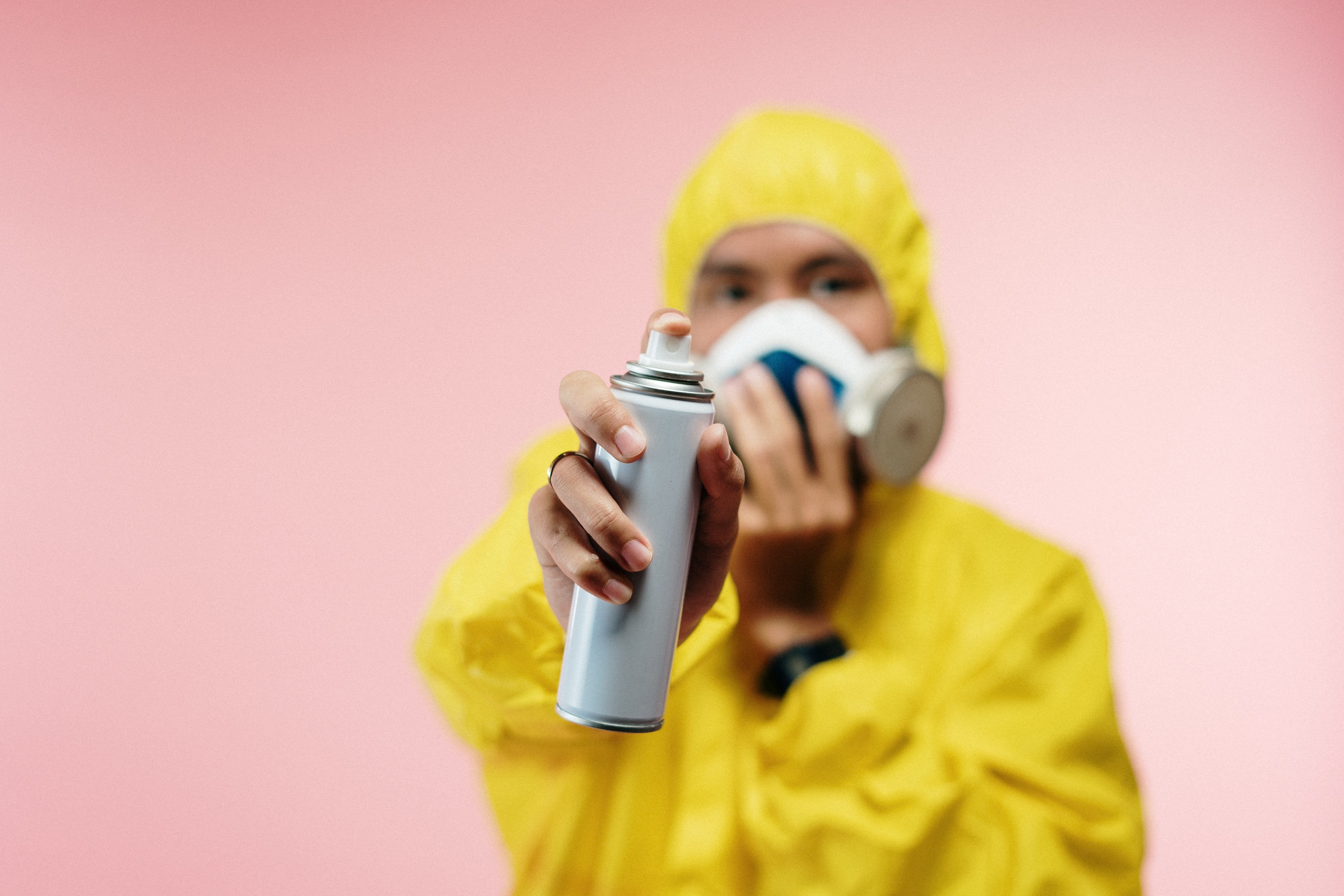 man-in-coveralls-holding-spray-bottle-3951389