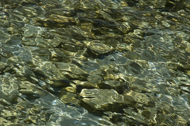 Sunlight on limestone rocks under water in Lake Michigan